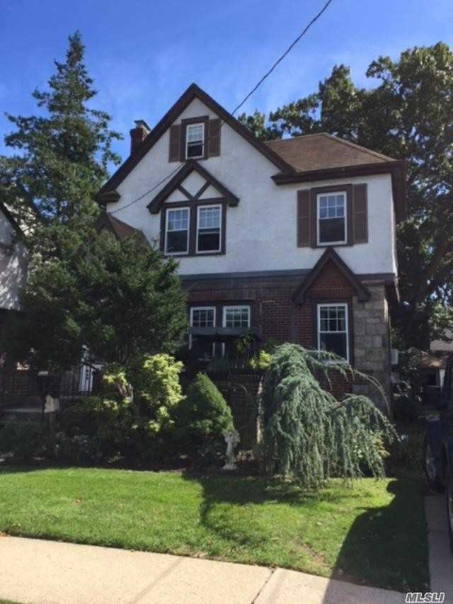 Mid-Block Tudor Colonial In The Heart Of West Hempstead. Living Room W/Fireplace, All Hardwood Floors Must See To Be Appreciated. Close To Parkway And Transportation. Location, Location, Location....