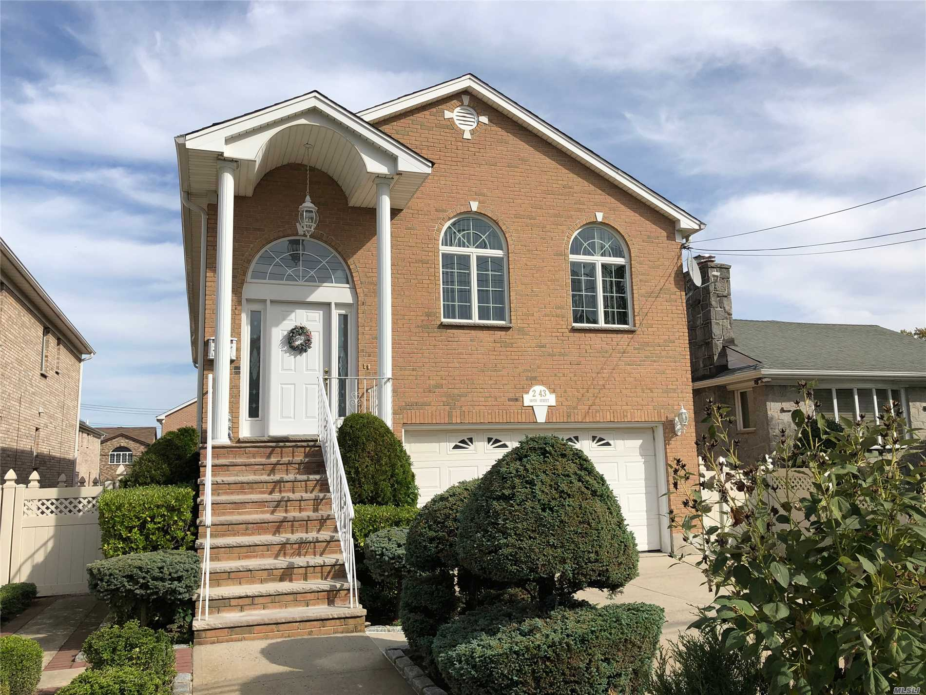 Beautiful Brick 3 Floor High Ranch For Sale In Whitestone! 4 Bedrooms, 3 Full Baths, Living Room, Formal Dining Room & Spacious Eat-In-Kitchen With Ss Appliances, Custom Cabinets & Granite Countertops. Family Room, Great Room With Gas Fireplace & Boiler Room. Hardwood Flooring Throughout & Cac. Full Basement With Separate Entrance, 2 Car Garage And 2 Car Driveway. Located Near Park With Gorgeous Views. 40X107 Lot. A Must See!