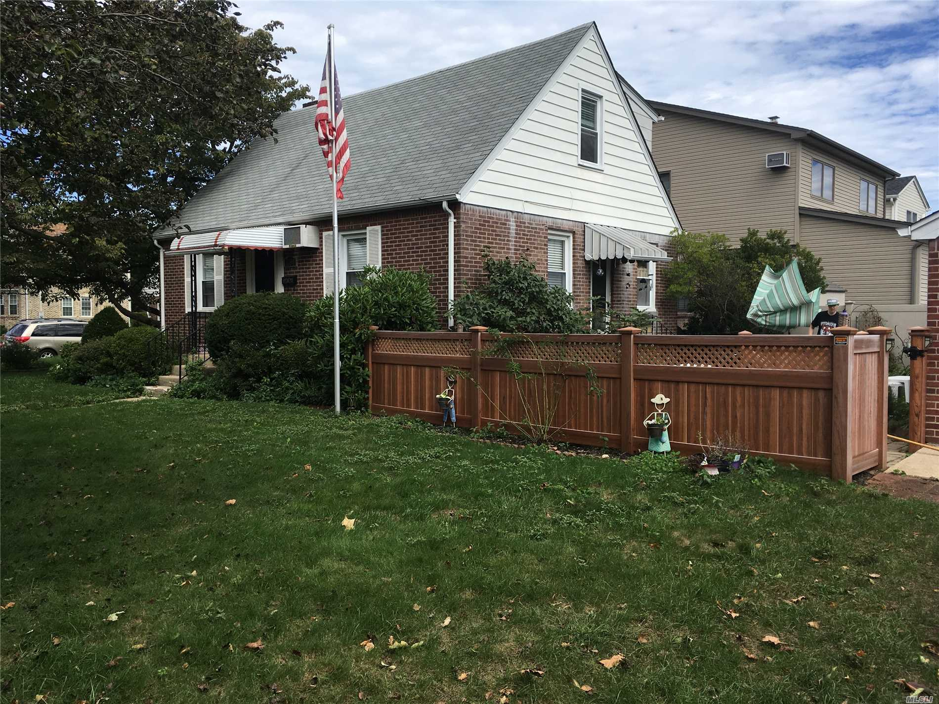 Near All! Yard Fenced, Updated Roof, Heating, Electrical. Great Neck Schools. Rear Dormer. Needs Tlc!