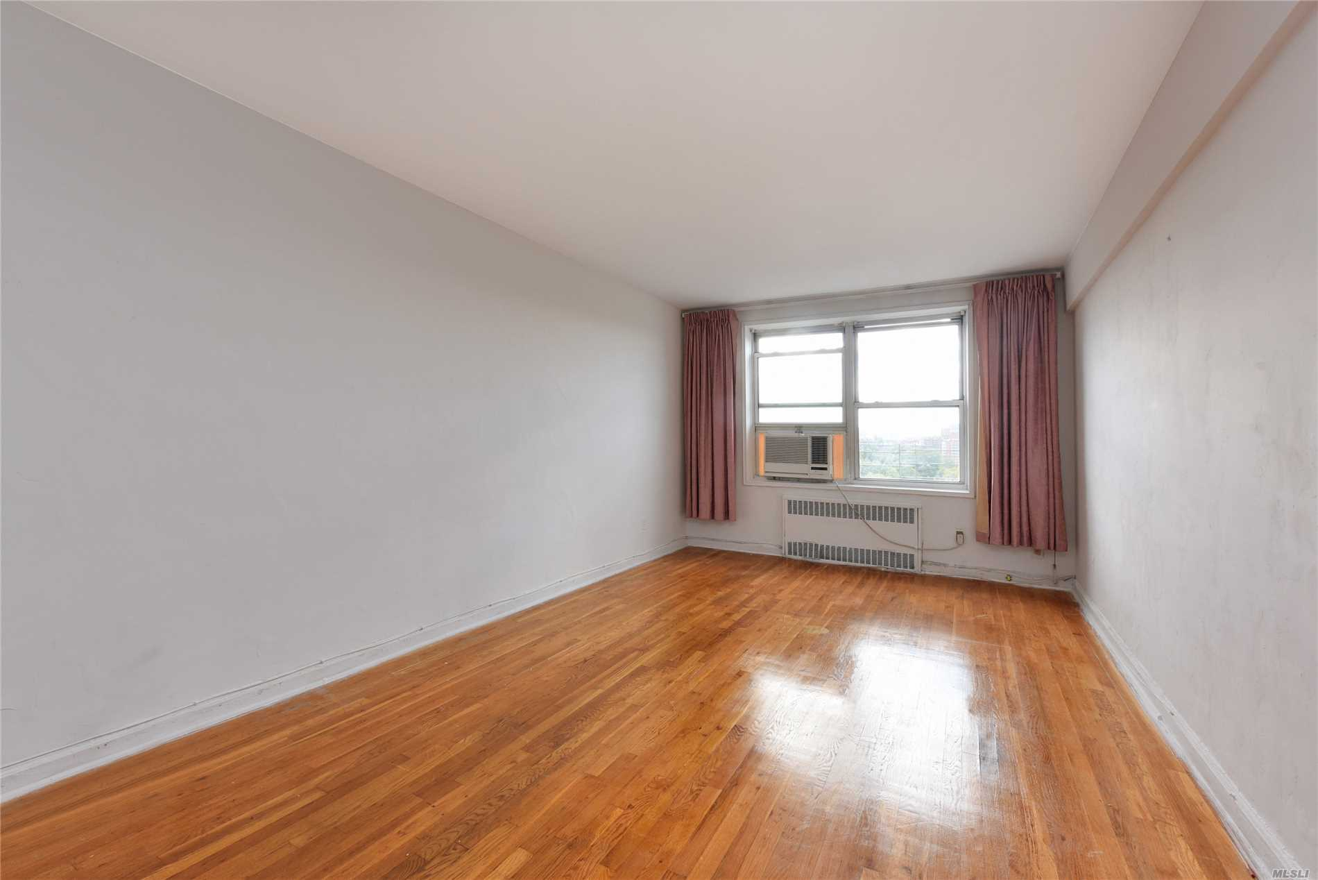 Largest One Bedroom Corner Coop Unit On Prime North Flushing Area, Top Floor With South Exposure , Real 800Sf Living Space , All Window In Kitchen And Bathroom, Low Maintenance Including All , Move In Condition With Hardwood Flooring Throughout, Fresh Painted Whole Apartment, Lot Of Closets, Formal Dinning Area , Entry Foyer,  Multi-Lines Of Bus Steps Away From The Building, Best Layout In The Building, Close To All Supermarket , Shopping Center, Major Highway , School, Post Office, Library...