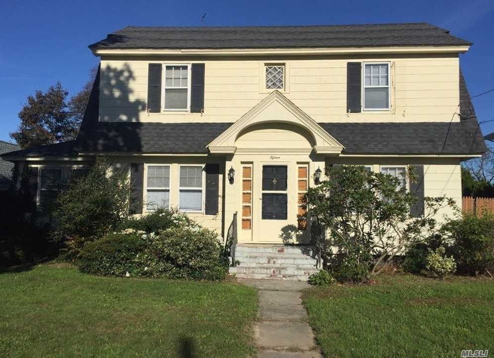 Heart Of Sayville, Walk To Shopping, Trains, Dining. Lovely Home Waiting For Tlc . Do It Your Way! Great Bones, Functional F/P W Built-Ins, Maple Harwood Floors, Year Round Sunroom/Family Rm. Nice Fenced In Property W Det 2 Car Garage.