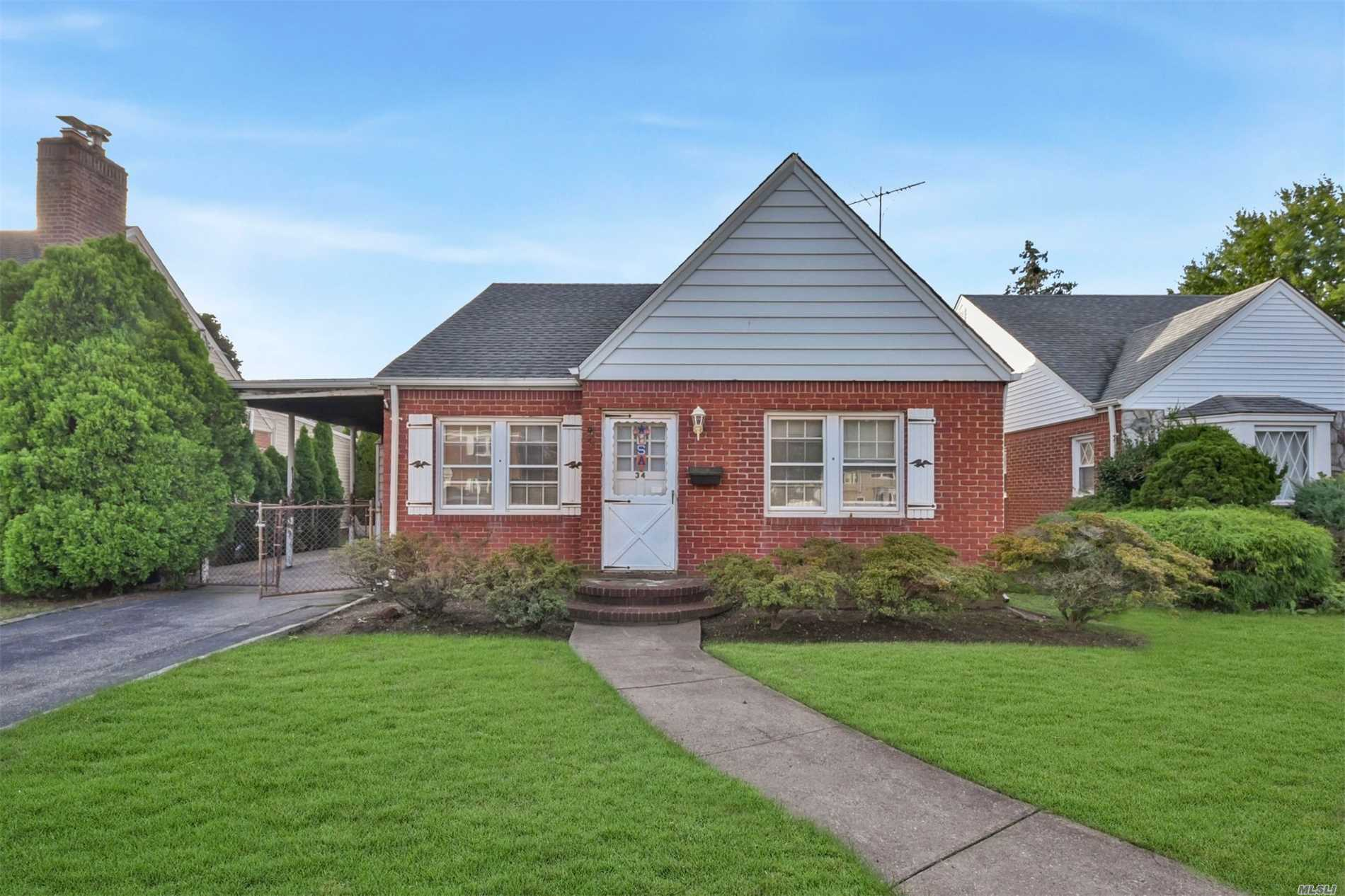 Brick Cape With Rear Dormer Located In The Manor Section Of New Hyde Park. This Home Features Living Room, Formal Dining Room, Kit, 5 Bedrooms, 2 Full Baths, Fully Fenced Private Yard. Close To Schools, Shopping, Restaurants & Transportation.