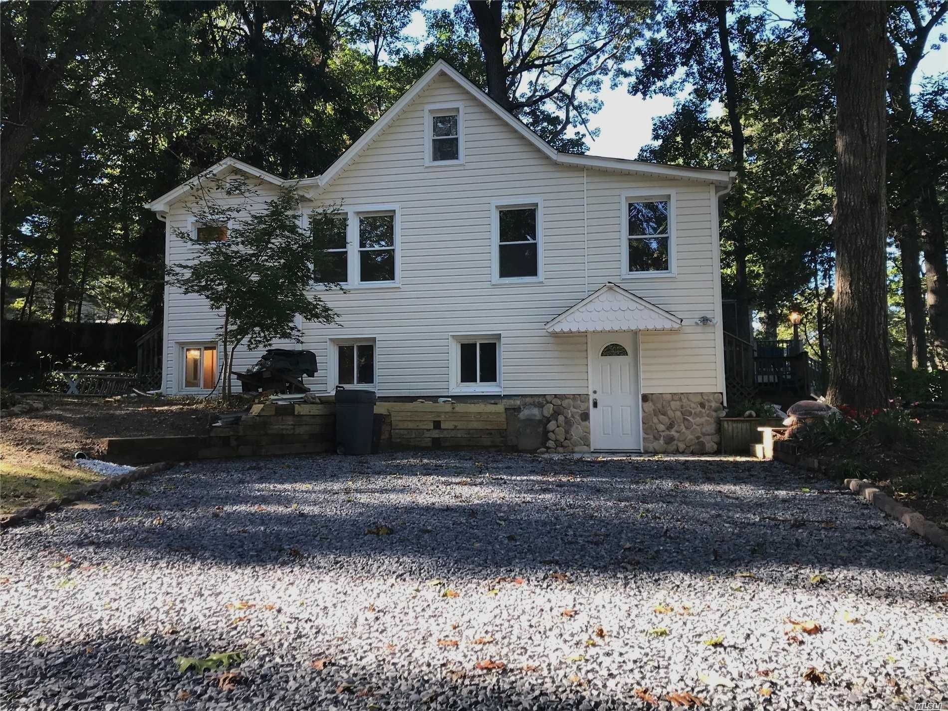 Newly Renovated Home With New Kitchen, Two New Bathrooms, New Flooring Throughout, New Siding And Windows. Large Driveway For Multiple Cars. One Block From Private Beach. Seller Will Pay First Year Beach Rights $425