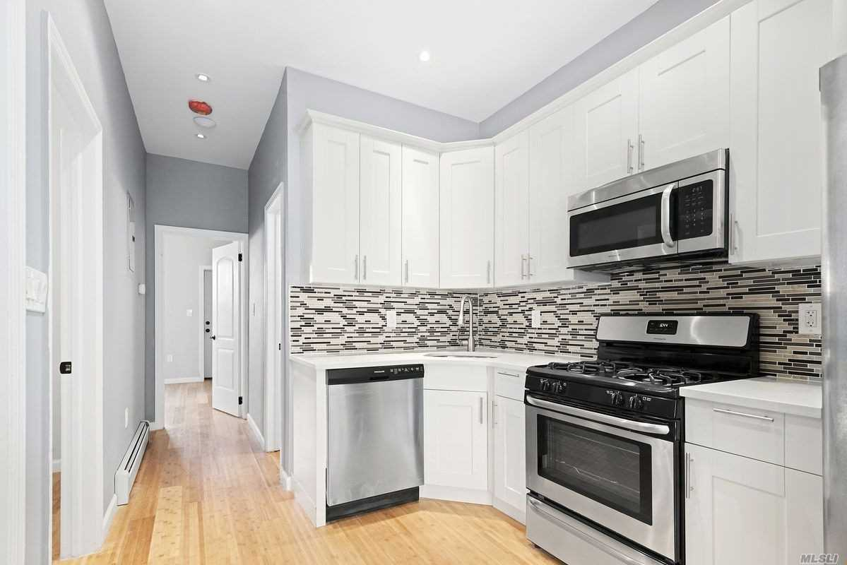 Bring Your Things And Live In This Luxuriously Renovated Brick Two Family Featuring A Private Driveway! Configured As A 2 Bedroom Rental Which Can Generate $2, 000/ Month To Assist With Mortgage Payments Over A 2 Bedroom Owners Unit Which Can Easily Be Used As A Duplex With The High Ceiling Finished To Create Additional Living/Recreational Space. Chefs Granite Kitchens Equipped With Stainless Steel Appliances, Wood Floors Throughout, Fully Tiled Bathrooms! Close Proximity To Transportation!