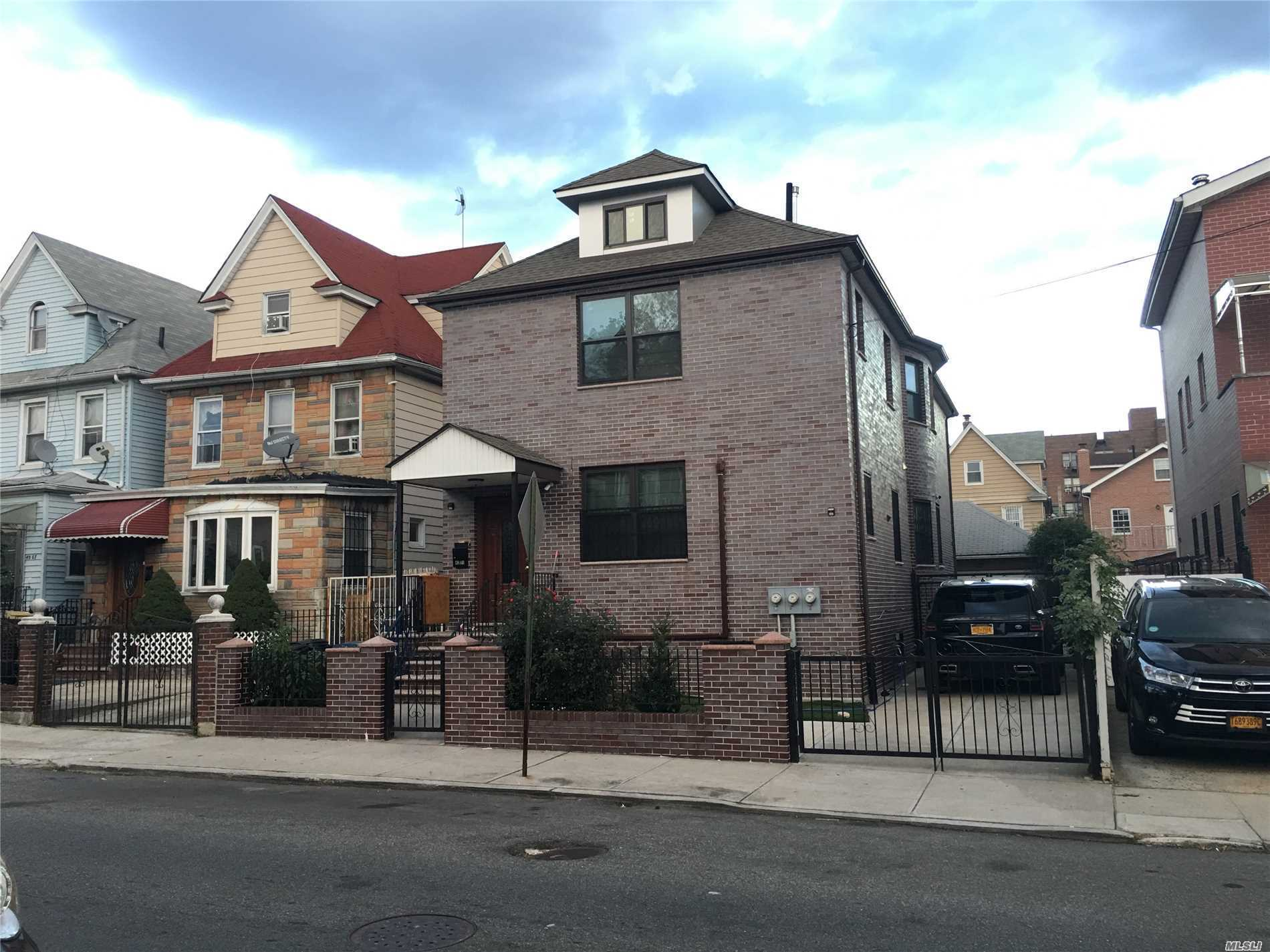 Rare Beautiful Brick 2 Family Detached House In Center Of Elmhurst, Entire House Re-Done The Work From Inside To Outside. Wood Floor,  Marble Kitchen, Center Air Condition In Whole House, Full Finished Basement With A Lot Of Windows High Ceiling, Laundery Room, 2 Boilers, Access To Back Yard. 5 Minutes To M, R Train, Supermarket, Park,  6 Minutes To 74 Street Roosevelt Subway Station E, F, M, R, 7 Train Station,  Convenience To Everything.