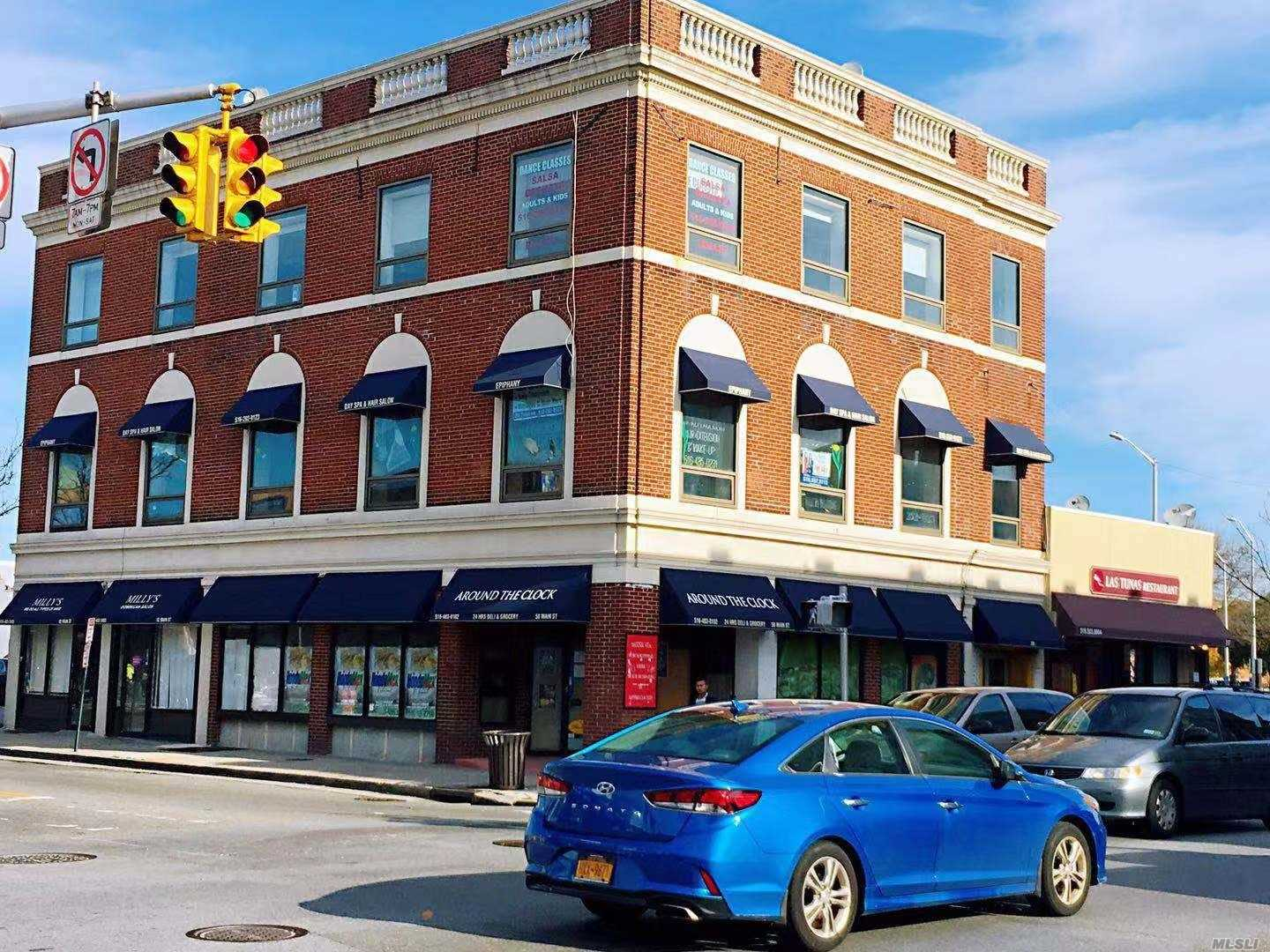 At The Heart Of Hempstead, Corner Lot Cross Main Street In High Foot Traffic Area. 2 Blocks To L.I.R.R. Station. 3 Ground Floor Retails: 2 Restaurants & 1 Salon) & 2 Office: (3rd Floor Dance Studio & Vacant 2nd Floor). Separate Utility Meters For All Units.