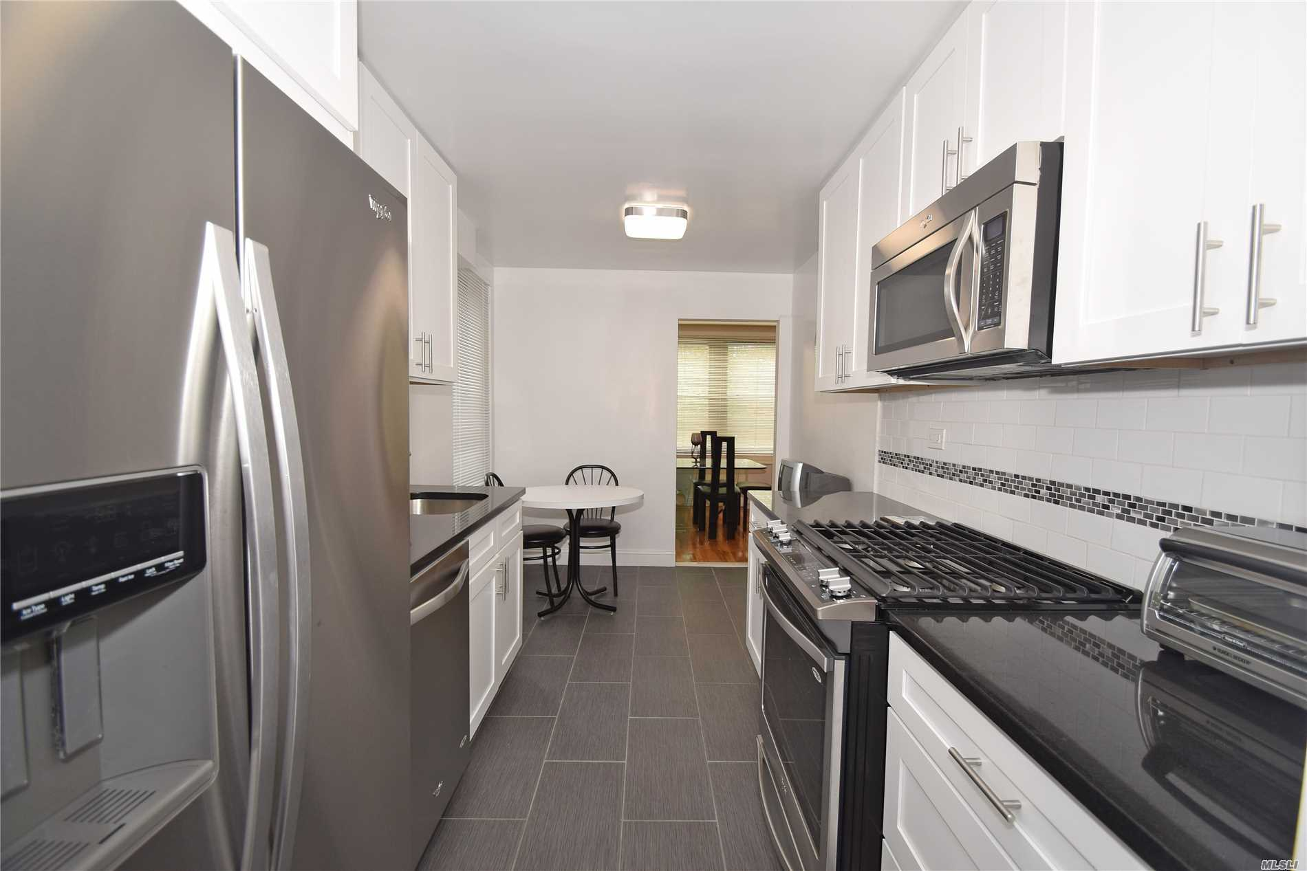 Bright Western Exposure Highlights This Over-Sized 1250 Square Foot 2 Bedroom Plus 2 Full Newly Renovated Baths And Newly Renovated Gourmet Style Eat In Kitchen. Located In The Heart Of The Beautiful And Convenient Bay Terrace Community. The Apartment Has Been Recently Renovated With To Many Features To List. Highlights Include Beautiful Gleaming Hardwood Floors Throughoutp Plus Central Air/Heat Closets Galore And Reserved Parking. Minutes To The Lirr And Express Bus Right Outside Your Door.