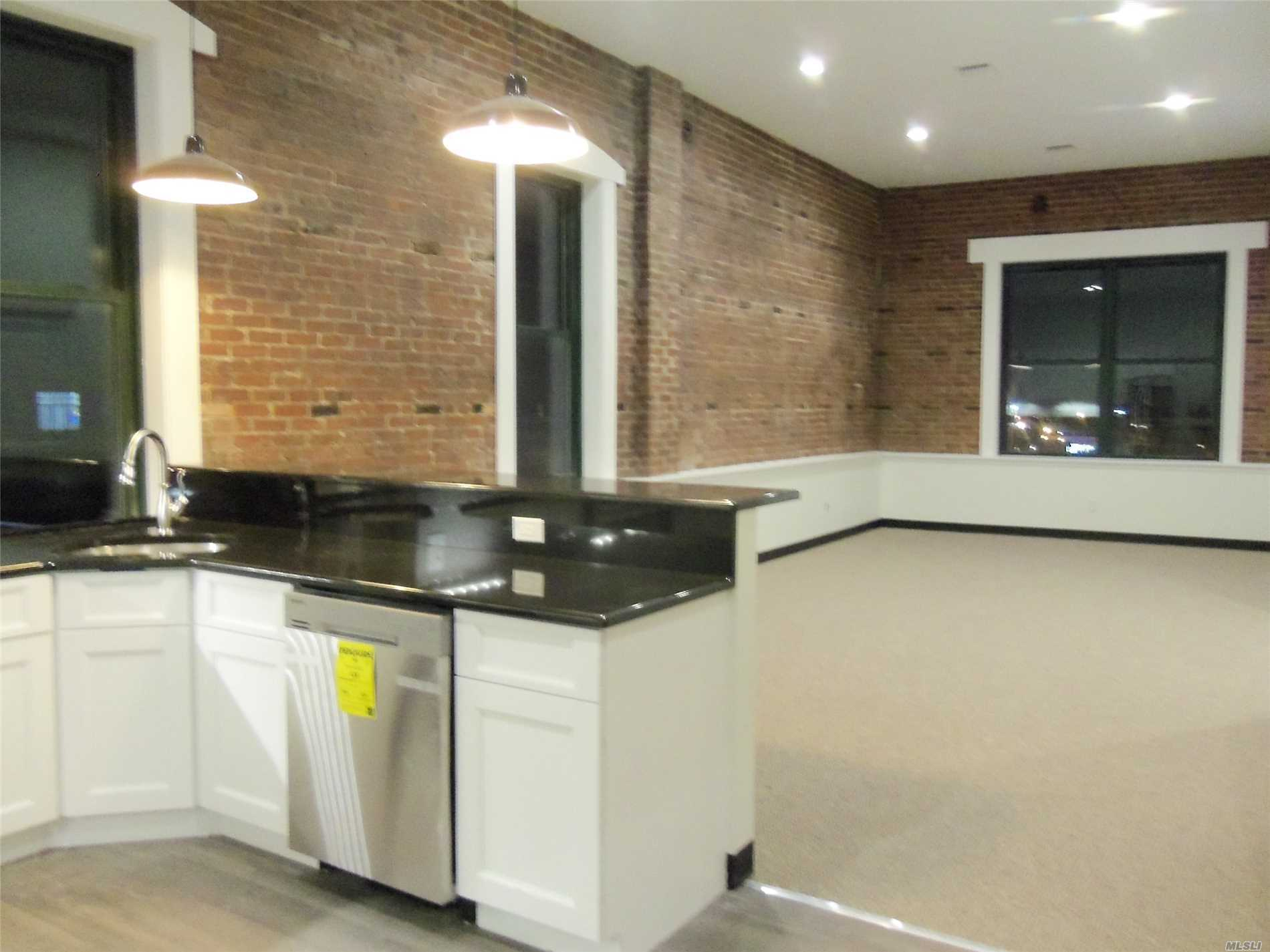 Stunning One Bedroom Apartment With Exposed Brick Walls And High Ceilings. Gorgeous Kitchen, Huge Living Room/Dining Area, Bedroom And Bath, All Brand New. Features Include New Stainless Steel Appliances And Washer And Dryer In Unit, Cac And All New Windows. Great Location Across From Lirr Station-40 Minutes To Manhattan!