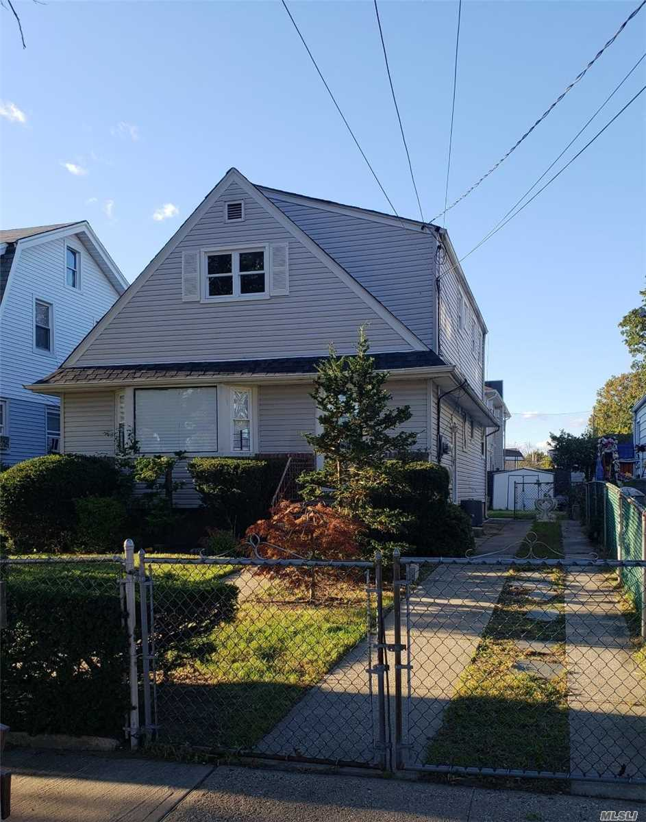 Renovated Two Family In The Springfield Gardens /Jfk Area Off Rockaway Blvd. This 2 Br Over 3 Br Is Sitting On A Spacious Manicured 40X100 Lot. New Appliances, Updated: Plumbing & Electrical (All Energy Saving Led Lights). Hardwood Floor & Crown Moulding Throughout. Full Finished Basement With Separate Outside Entrance.