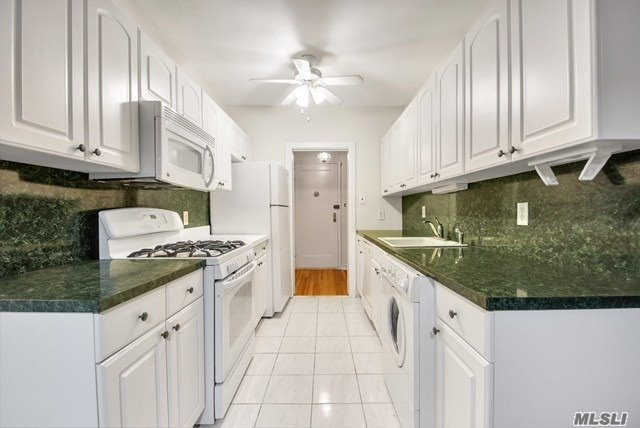 Two Bedroom Is Located In A Premier Cooperative Community In Historic Beechhust, In Whitestone. With Pristine Blonde Oak Hardwood Flooring Throughout, High Ceilings, And Windows Everywhere, This Layout Is Spacious And Leaves Room To Grow. The L-Shaped Living Room Has A Dining Nook That Easily Converts To A Home-Office. The Private Covered Balcony Overlooks The Treetops And Faces Back Of The Building. Two Bedrooms- The Master Is King-Sized With A Huge Walk-In Closet.