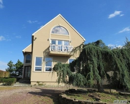 This Waterfront Colonial On The Long Island Sound Features 4 Bedrooms, 3.5 Baths, Formal Dining Room, Living Room W/ Fireplace, Eat In Kitchen. Master Br With Full Bath, Fireplace, Office And Sitting Room, Tile Flooring & 2 Detached Car Garage. The Beach Is In Your Backyard. Centrally Located To All. Don't Miss This Opportunity!