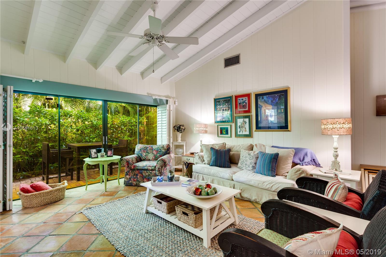 Top Location Within Walking Distance To The Coral Gables Library & Youth Center For This Charming 1950'S 2 Bedroom 2 And 1/2 Bath Home Which Has A Den Which Could Easily Be A Third Bedroom. Dramatic High Open Beamed Ceilings In Large Foyer And In Living And Dining Areas - Great Room Effect With Large Expanse Of Sliding Glass Doors On Both Sides Of The Room For Terrific Cross Ventilation Effect. 2068 Actual Square Footage. 5, 250 Sq Ft Lot With Charming Courtyard Style Garden At The Front Entry. House Sits At Back Of Its Lot And So There Is No Room For A Backyard Pool. Updated, White Kitchen, Oak Floors In Master Bedroom And Second Bedroom. Garage. Close To Riviera Country Club, Merrick Park And The University Of Miami.