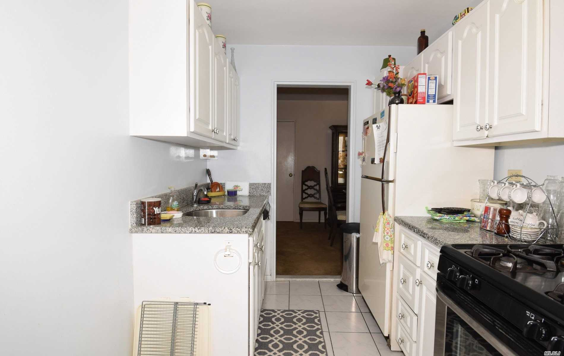 Sunny And Spacious 1100 Sq Ft (Junior 4) Corner Unit Apartment In A Great Building. Maintenance Includes All Utilities (Heat, Water, Gas, Electric). Convenient To Transportation, Express Bus To Manhattan And Bay Terrace Shopping. Elevator Building! Parking Space Available $31/Monthly. Plenty Of Closets Throughout. Seller Paid Assessment.