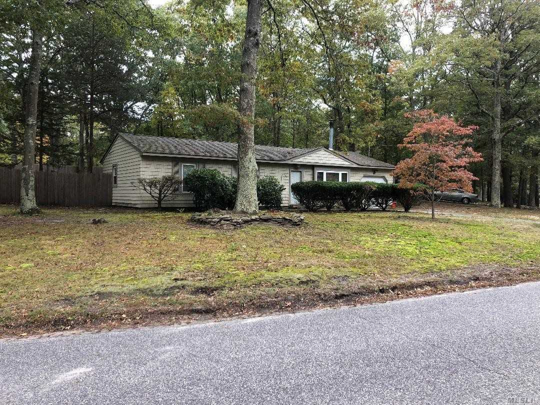 Extremely Private Home Situated Near Protected Land And Peconic Lake. Pleco Organization For Use Of Lake($50/Yr Membership Fee) , Boats And Canoes. Updates Inc. 2009 Roof 30 Yr Arct. Style, Comfort Series Vinyl Tilt Windows, Newer Heaters 2014, Water Storage Tank 2012, Kitchen W/ Cherry Cabinets, Granite And Ceramic Tile, Ss Appliances, Bath, Washer, Dryer, Pergo Floors, 200 Amp Elec., Wood Burning Fireplace, Solid Wood Raised Panel Doors And Much More!!! Low Taxes!!!! With Star $6032.62!!!