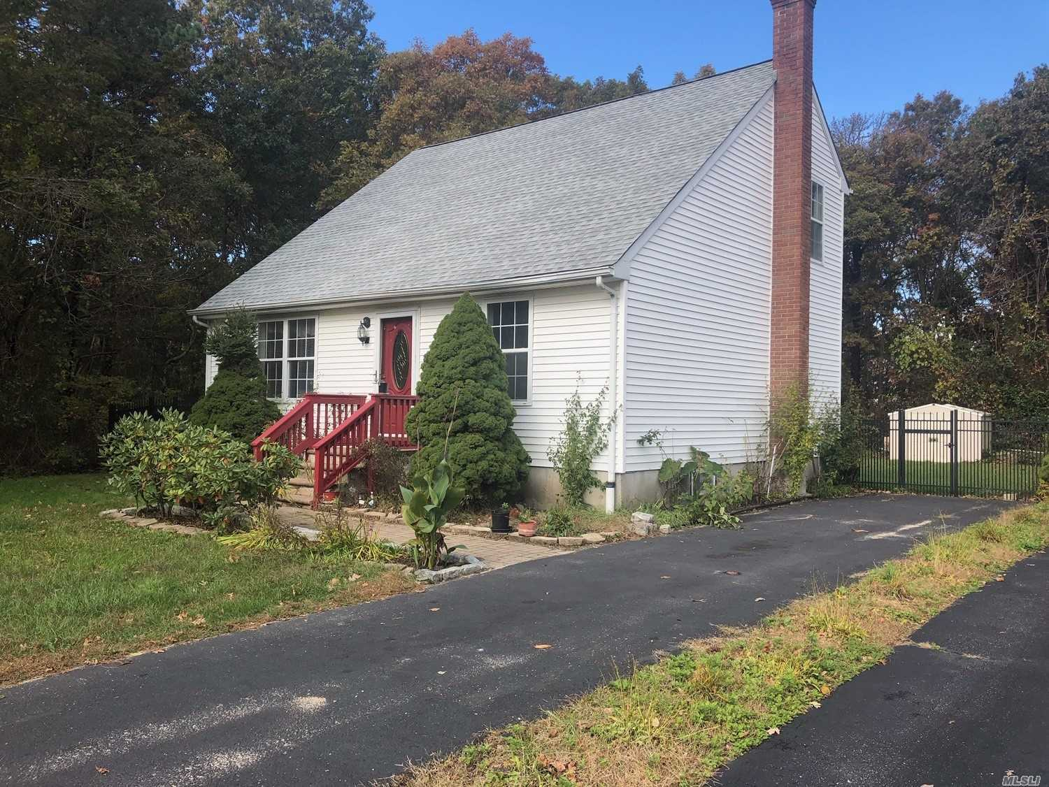 Beautiful Cape Brand New Roof, Four Bedroom, Two Full Bath,  Vinyl Siding. Low Maintenance, Fenced In Yard, Wrought Iron Fence Belgium Block Walk Way. Turn Key Ready To Move In Tomorrow. 5-Minute Drive To Smith Point Ocean. Nice Flat Private Property.