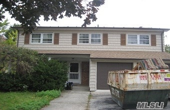 Single Family Colonial Home For Sale In Douglaston. Needs Tlc-Great Opportunity. House Sits On A 60X100 Sq Ft Lot. Features 4 Bedrooms, 2.5 Baths, Lr, Dr, Eik, Den W/Fp And Full Basement. Cac. Attached 2 Car Garage. In District 26, Wont Last!