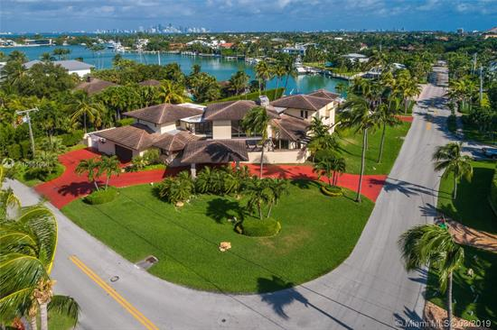 Significant Opportunity To Own A One Of A Kind Property With Over 31, 458 Sq. Ft. Of Land, Situated On Exclusive Mashta Island And Overlooking Hurricane Harbor. This Amazing Corner Lot Residence Is The Perfect Jewel For Boaters Or Water Sport Lovers.Enjoy The Peaceful Waters Of The Harbor And Be Amazed By The Passing Dolphins Or Manatees. This Home Offers A Spacious Floor Plan With Over 6, 020 Sq. Ft. (Under A/C). The Formal Living Area Is Enhanced By Double-Height Ceilings Plus A Separate Formal Dining With Views To The Pool And Harbor, A Specious Kitchen With Breakfast Area And A Wonderful Family Room.The House Has 6 Beds/4.5 Baths. The Covered Terrace Has A Built-In Bar And An Expansive Oversized Pool Area Perfect For Those Who Love To Entertain. House Is Elevated And Has A 2 Car Garage.