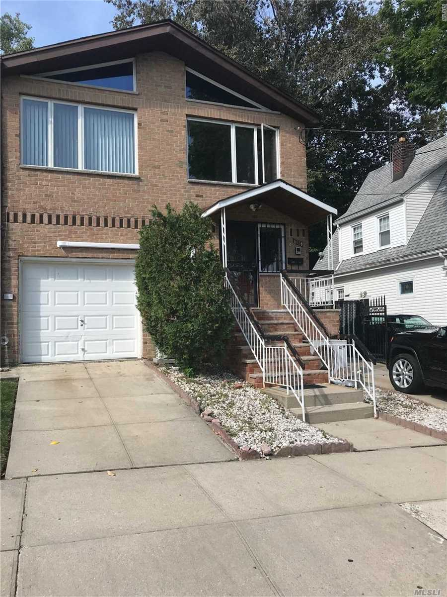 Fully Renovated Brick Semi-Detached Two Family House With Private Long Drive Way. Wood Floor Throughout. Full Finished Basement With Separate Entrance. 1st Fl: Lr, Ki, 2Beds, 1Bath 2nd Fl: Lr, Ki, 3Beds Convert To 2Beds, 1 Bath 1 Block To Ps 129, Close To Transportation, Park, Shopping Center, Etc.