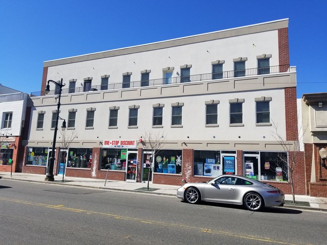 2016 construction - Prime investment opportunity in billboard location. Heavily trafficked Post Avenue 1/2 block North of Westbury, LIRR Station. 15,000 sf - f.s.b. - 3 story elevator building with full basement. Fully tenanted with leases 10 apartments all 1 bedroom and single retail tenant occupying ground level and basement.  All electric building, separately metered - each unit with their own fuse box Each unit has 2 HVAC remote controlled wall units Each unit has washer/dryer Each unit with video intercom Hardwood floors throughout Granite and stainless steel kitchens Retail space could be 6 independent spaces, doors already in layout  Prime Investment opportunity or 1031 Exchange Tax stubs and payment receipts available with request 7 year Tax Abatement remaining 2016 construction, Front faces East, Rear faces West Direct access to LIRR and Parkways