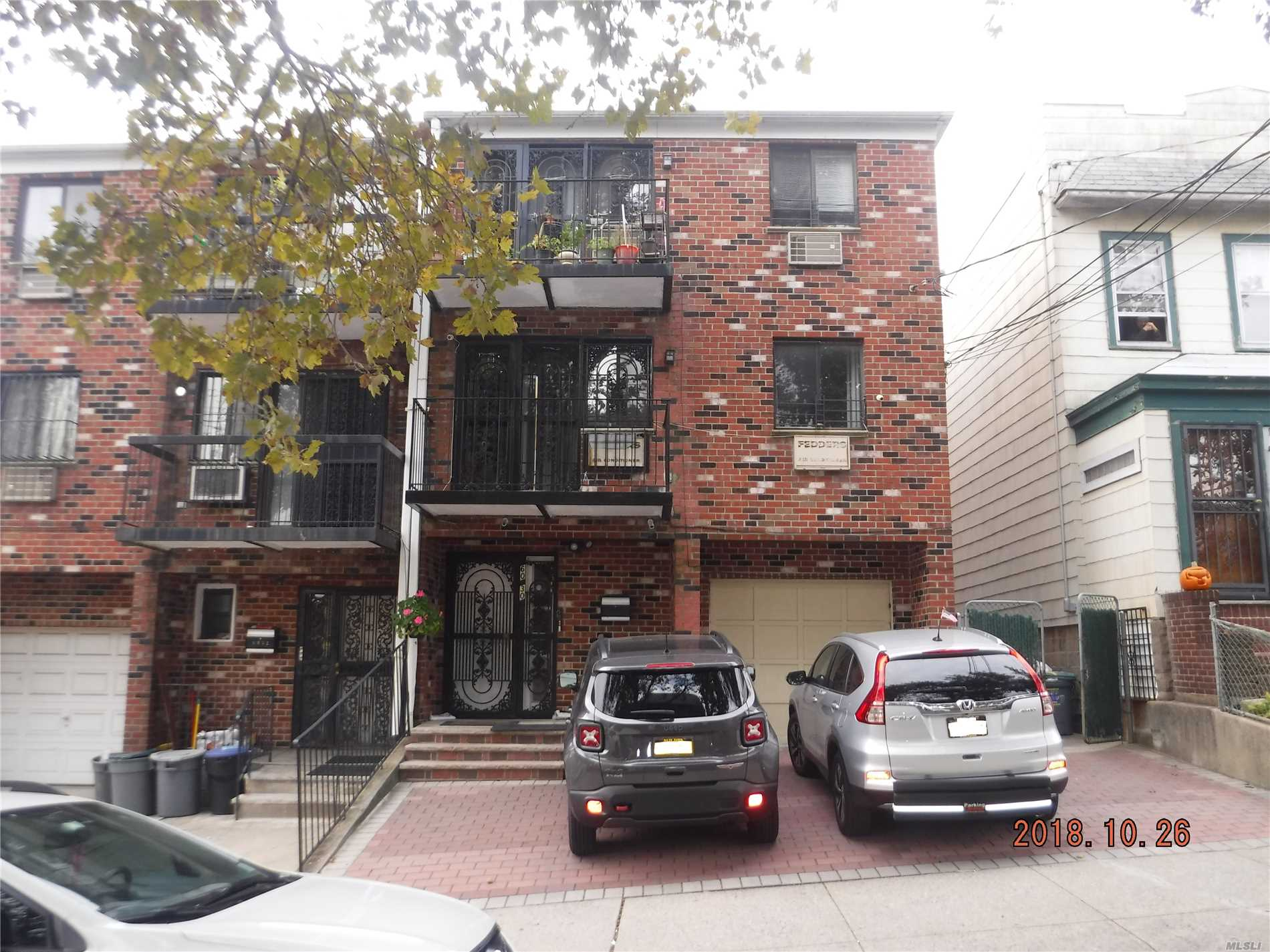 Excellent Location In Quiet Middle Village Area. Solid Brick Legal 3 Family Home, Very Well Kept. Easy To Show. Close To Queens Center Mall And Transportation. Sprinkle System On Staircases