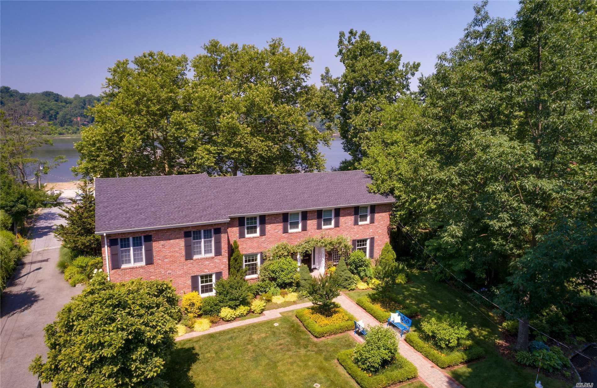 Manhasset Bay Waterview Lovely 5 Bedroom Brick Colonial. Enjoy This Tranquil Setting. Well Appointed Rooms Throughout. Bonus-2nd Floor Bedroom Suite Featuring Br, Lr, Full Bath, Walk In Closet And Private Staircase. Wonderful Landscaped Property. Deeded Water Rights.