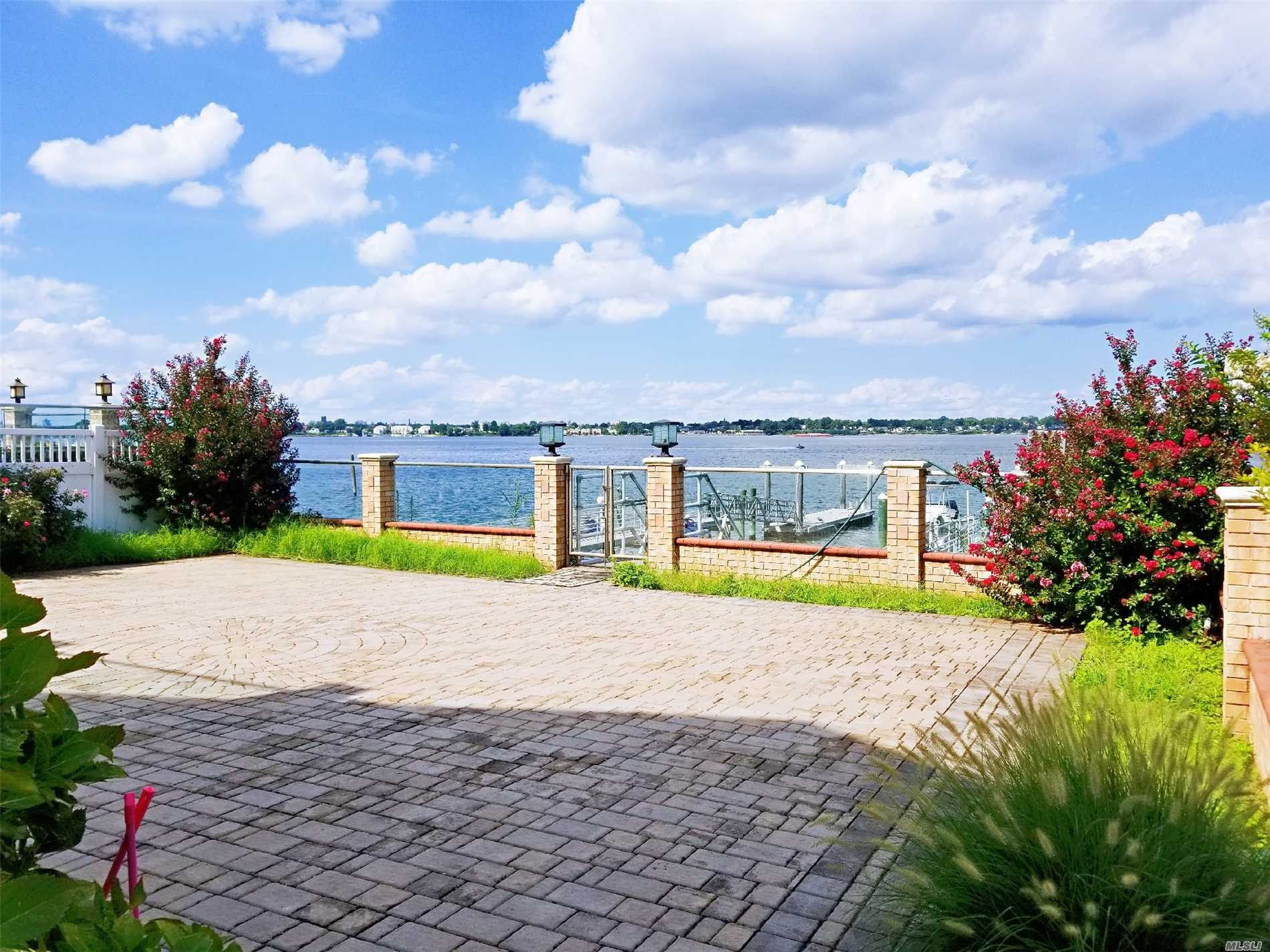Beautiful Long Island Sound Views With Private Dock+Beach. Custom Built Brick Colonial With 2 Master Suites . 3 Bedrooms, Lg Living Room, Formal Dining Room, Huge Eik, Family Room, 2 Cars Garage, Cac, Cv, 3000+Sq.Ft Living Space. 120 Ft Dock With Boat Lift And 2 Jetski Lifts. Private Beach. Located In Cul-De-Sac.