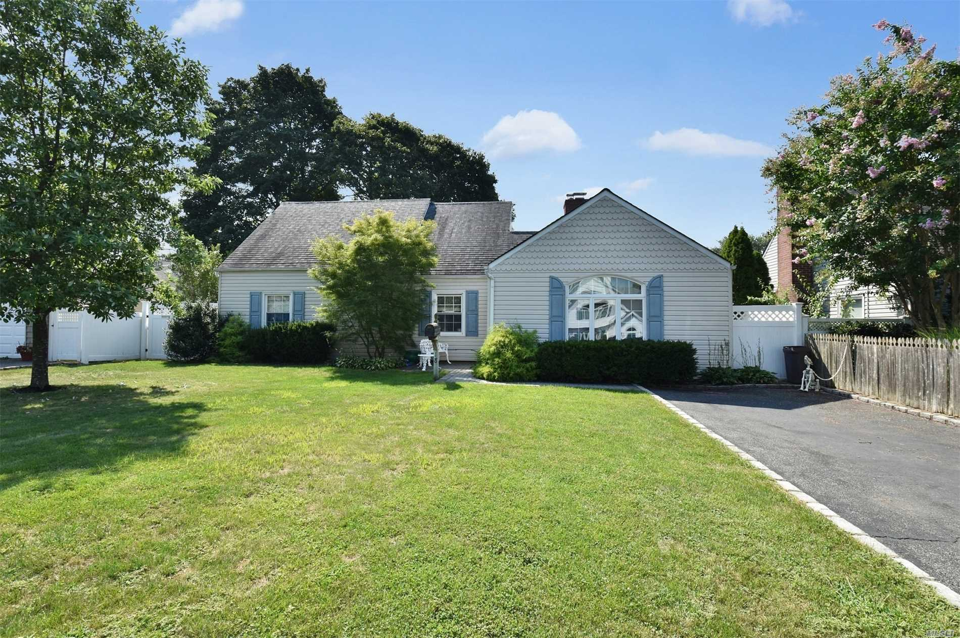 Expanded Mid Block Located Cape Featuring 3 Bedrooms, 2 Full Baths,  Kitchen, Dining Room, Living Room W/ Fireplace, Den, Part Basement On Nice 60 X 100 Property