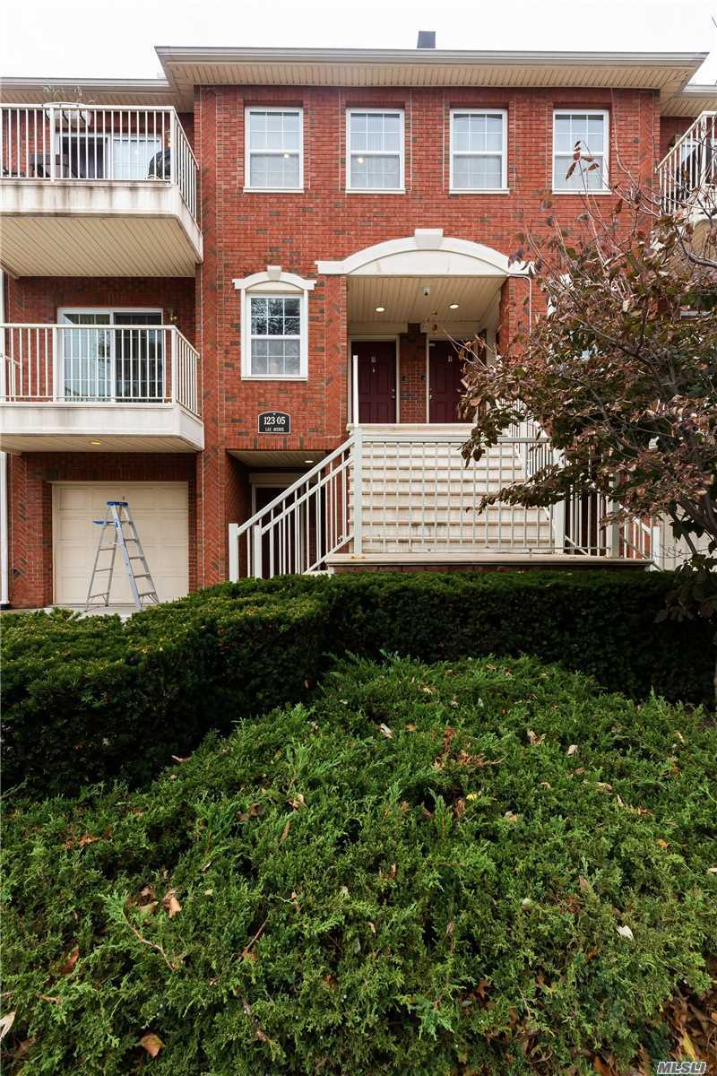 Charming Condo Unit In Great Condition! 3Bed 2Bath With Water View From Terrace In Master Bedroom. Unit Comes With A One Car Garage And Driveway For One More Car. Conveniently Located Near Waterfront Walkway. Tax Abatement Until 2026. Common Charges Include Snow Removal And Development Maintenance. Q25 Bus Line To Jamaica. P. S. 129 & J. H. S. 194. . Must See!