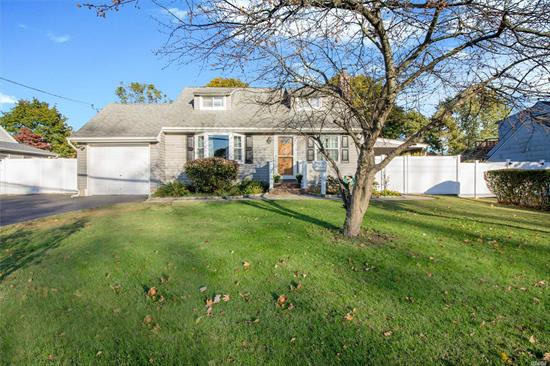 Beautiful Updated Cape In Award Winning Elwood School District. Move-In-Ready With New Eik, Stainless Steel Appliances, New Bath & Cac. Beautiful Hardwood Floors, Crown Molding, Fireplace & Updated Electric. Covered Deck & Spacious Yard. Close To All.