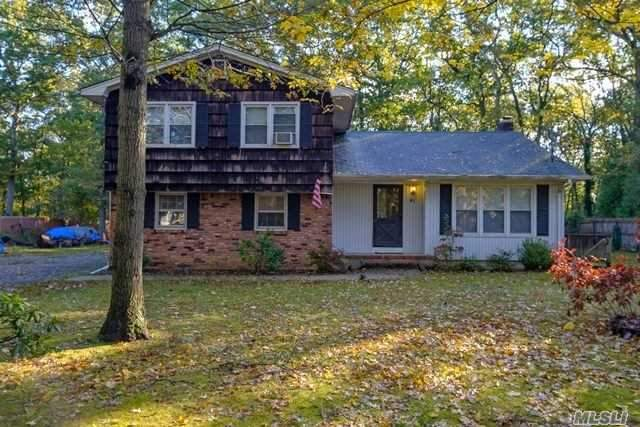 Colonial Featuring 5 Bedrooms & 3 Full Baths With Finished Basement W/Outside Entrance. House Is Set Back On A Large Piece Of Property. Mount Sinai Sd.