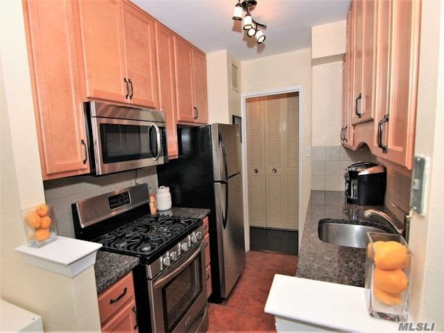 Luxury Building , Largest One Bedroom. Renovated Kitchen & Bath. Formal Dining Room (Can Be Used As A Den Or Office) Wood Floors. Cac, 24 Hr Doorman,  24 Hr. Security .Oversized Double Terrace With Water View Of Little Neck Bay, Restaurant/Deli/Grocery Store. Beauty Spa, , Pool, , Gym, Tennis.Close To All Shopping And Transportation.Total Maintenance $1233.00 W/O Garage