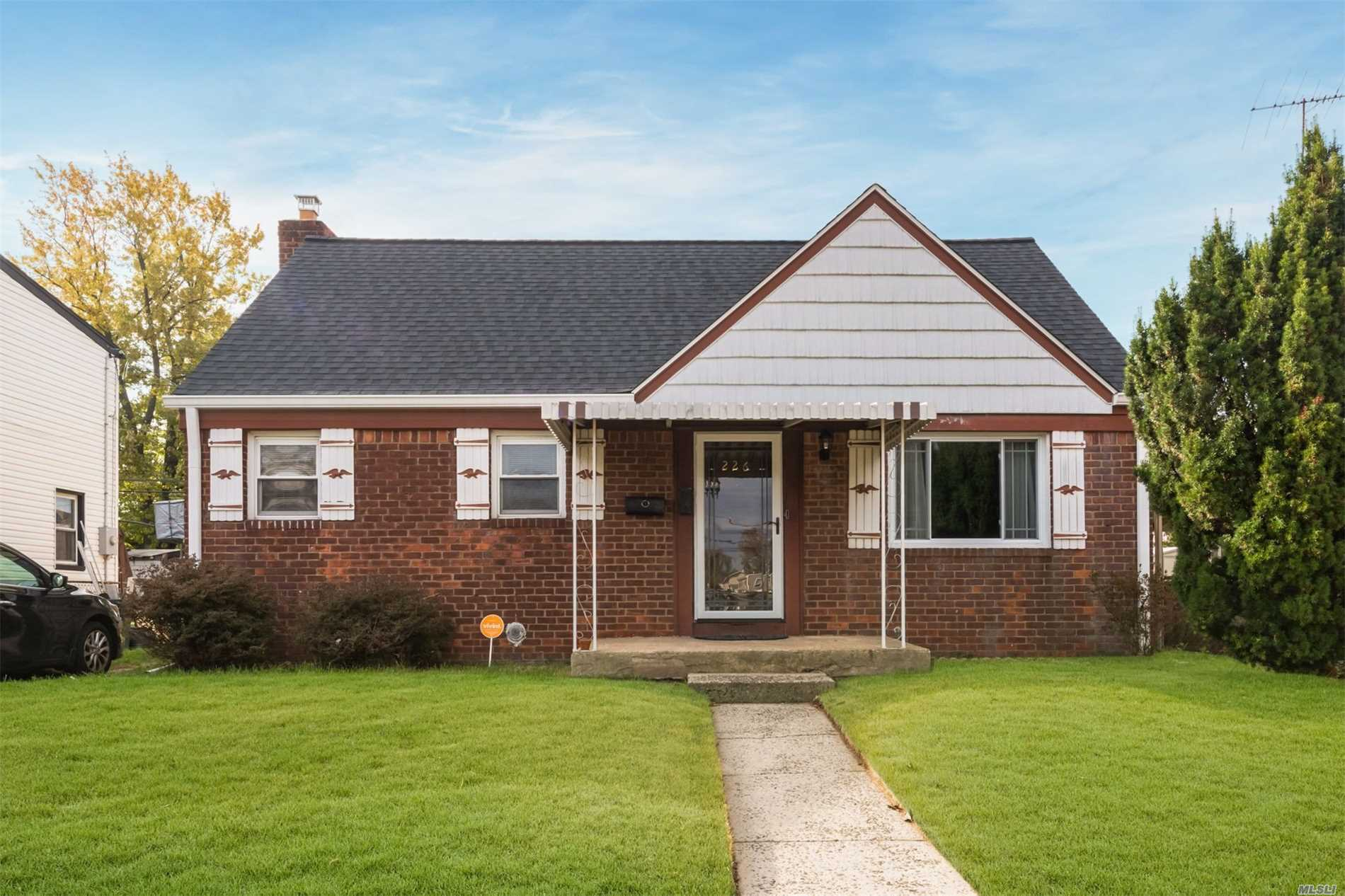 A Warm And Inviting Home With Wood Floors, A Sunroom, Large Basement, Formal Dining Room, Nice Size Bedrooms With Lots Of Closets Located In The Quite Residential Area Of Elmont.