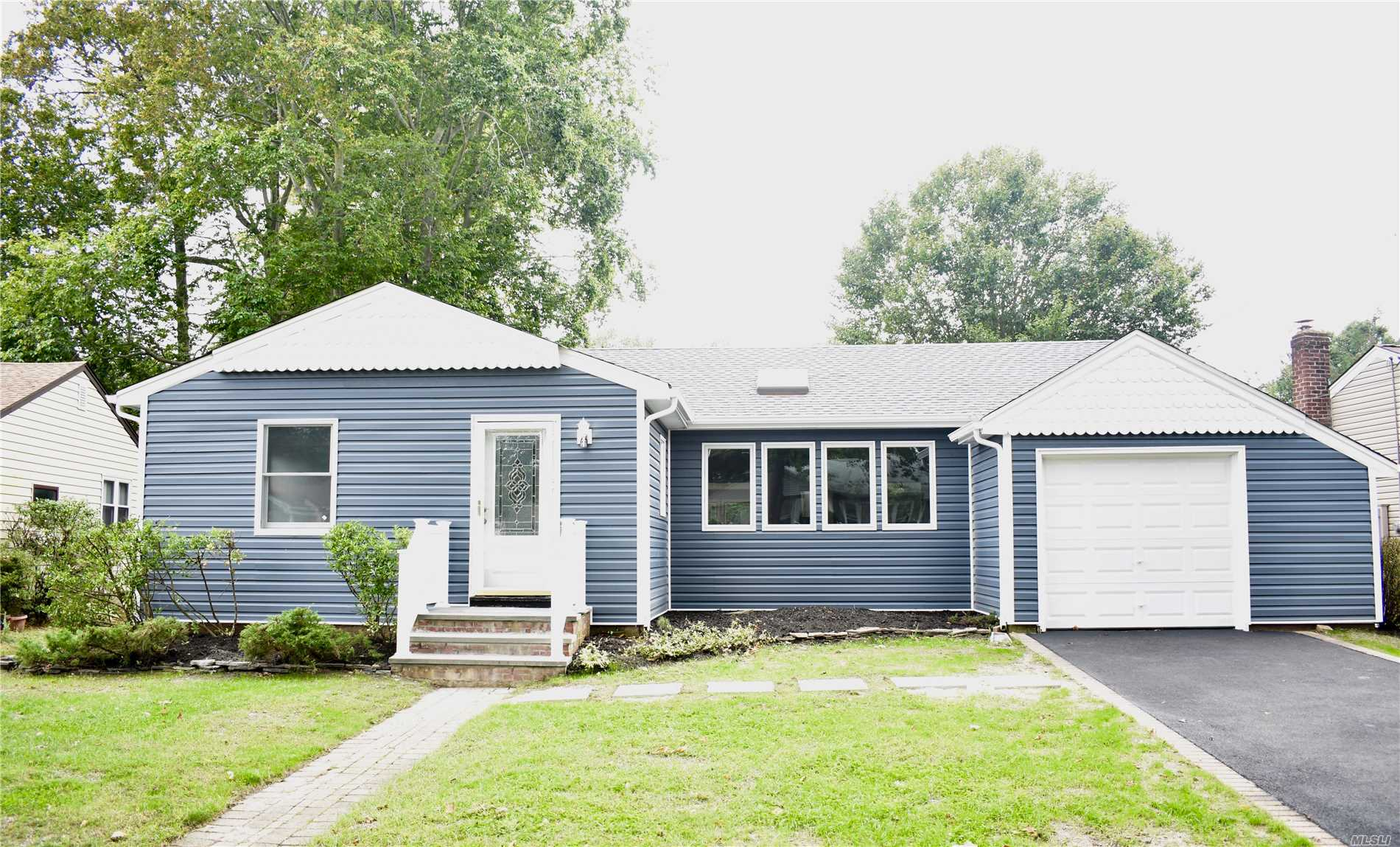Newly Renovated Home Features New Kitchen With Brand New Ss Appliances. Oak Floors, New Baths , New Siding And Much More. Beautiful Entrance Leading Into An Open Living Area With Skylights. This Home Is Nestled In A Quiet Area.