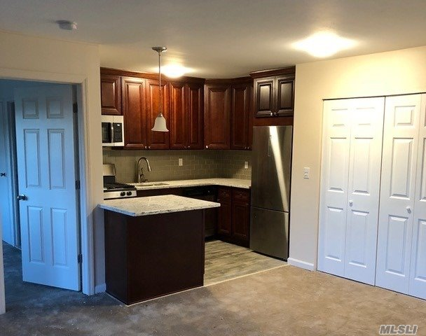 Enjoy Easy Living. Close To Shopping And Easy Access To Roadways. Totally Updated, Granite Kitchen, Marble/Stone Bath. New Carpet. Upper Unit. Great For Entertaining. Heat Included And Cable Silver Package Included Too. A Must See!!!!!! Enjoy Summer Living In The Renovated Pool.