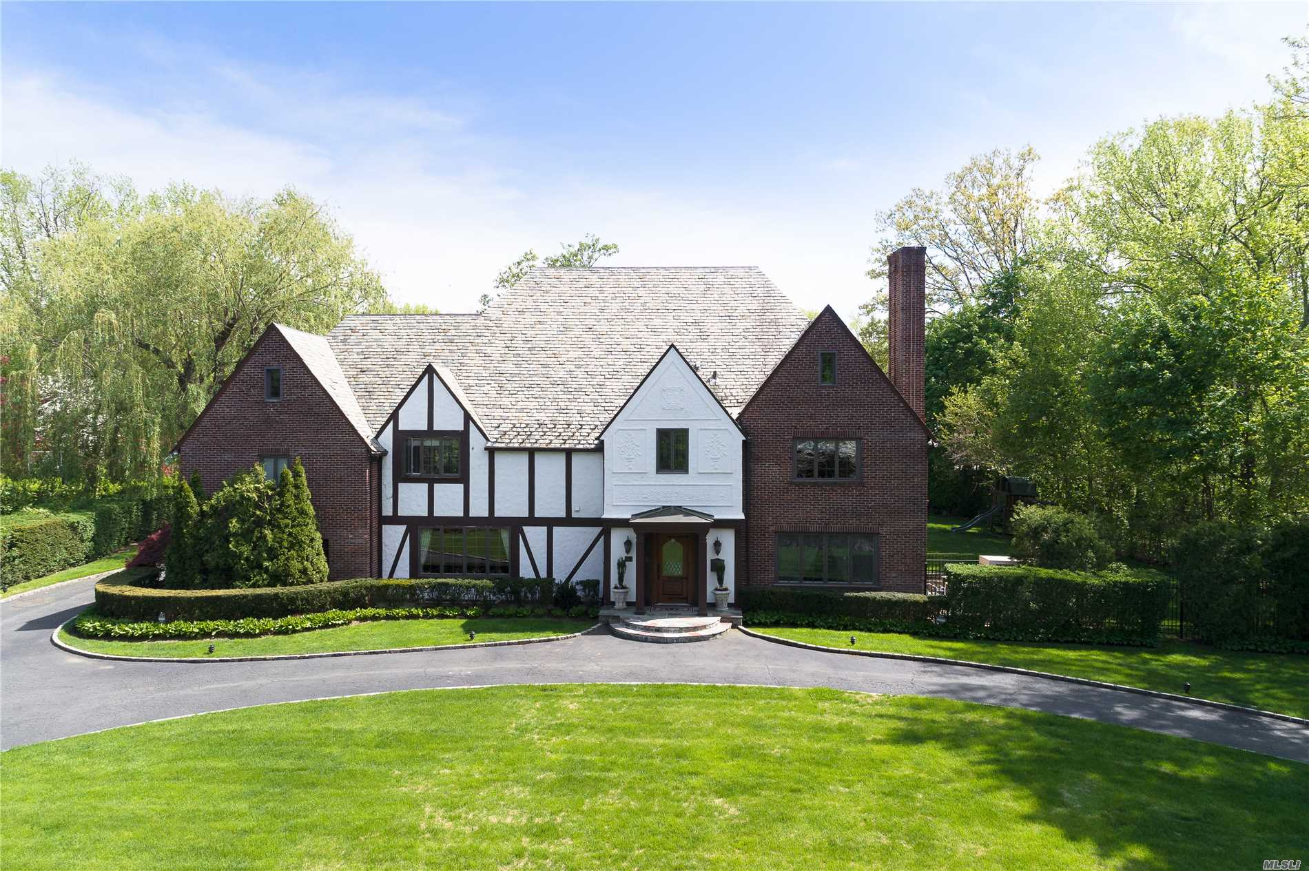 Move-In To This Majestic, Spectacular & Immaculate Tudor All Remodeled And Built For Fabulous Entertaining And Family Living. Newly Added Den And Mudroom Area. Full Finished Basement W/Maid's Rm And Bath. Complete With Inground Pool, Generator & 2-Car Garage.