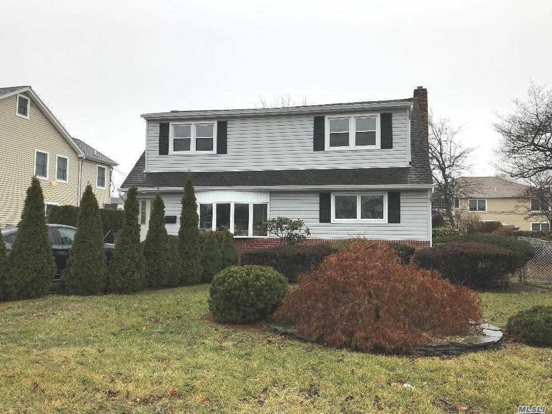 Magnificent 4 Br, 2 Bath Home In Carle Place Schools. Large Dormered Bedrooms On 2nd Floor, Hardwood Floors And New Carpet Through-Out. Professionally Landscaped.