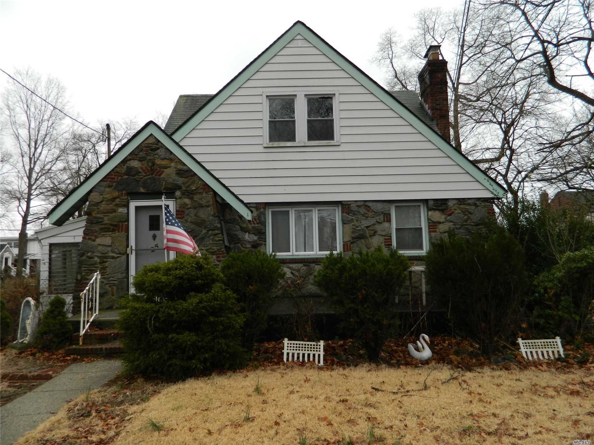 Legal 2 Family. 1Br Over 2 Br. Both Apartments Have Lr, Dr, Eik And Full Bath. Full Basement With Hi Ceilings. Large Corner Property With 1 Car Garage. Desirable West Wood Section. Close To Lirr, Schools, Shopping And Highways. House Needs Tlc But Comes With Great Potential.