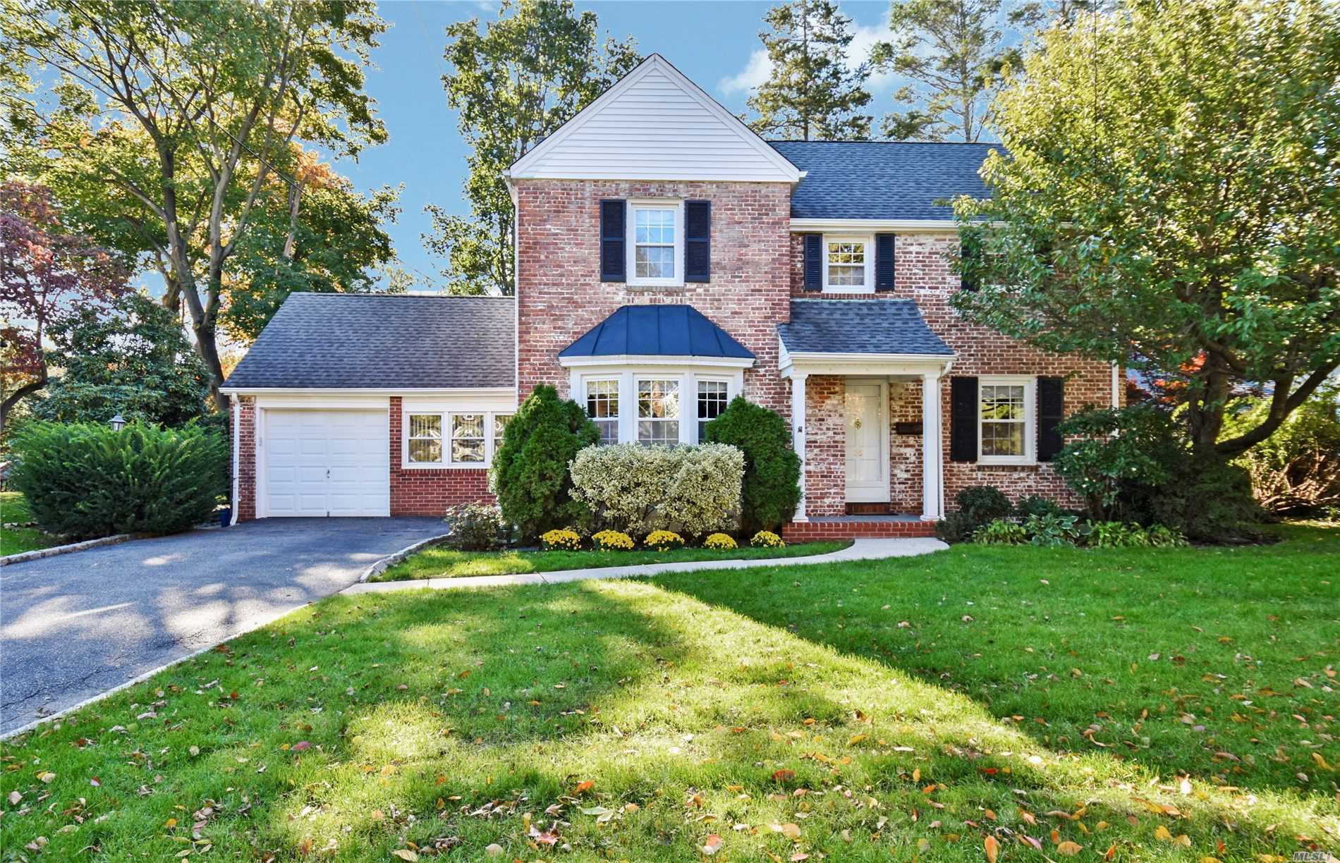 Welcome To East Williston! Curb Appeal Abounds This Center Hall Brick Colonial In The Heart Of The Village. This Lovely Home Offers Hdwd Fls, Cac, Lrm W/Fpl, Fdrm, Den, Newly Updated Kitchen W/Granite & S/S Appl's, Pwd Rm And Screened Porch. The Mbdrm W/Fbth And 2 Add'l Generous Size Bdrms, Hall Bth And Pull Down Attic For Storage Complete The 2nd Fl. Enjoy Extra Living Space In The Finished Lower Level With Rec Area , Ldry And Utilities. Close To Lirr, Parks, Shops And Award Winning Ew Schools!