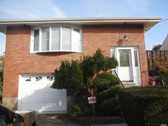 Beautiful Landscaped 3 Br Home With Large Family Rm W Fireplace & Large Yard On Tree Lined Street