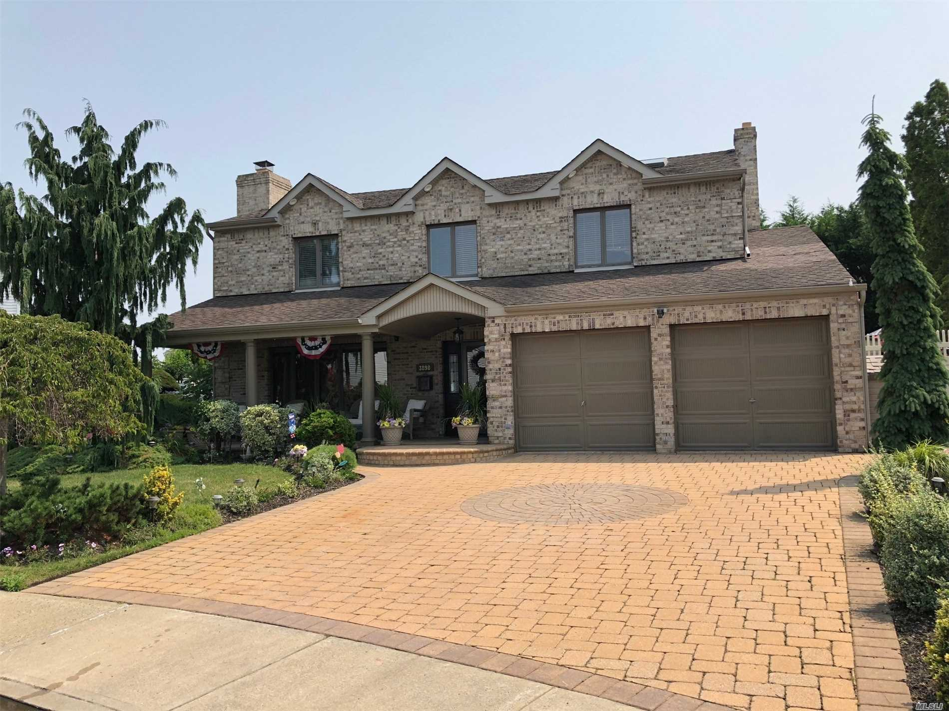 Magnificent Cul De Sac Colonial Gem! Upscale Main Level With Renovated Gourmet Kitchen And Baths. Backyard Paradise Ig Pool With Waterfall. Front Porch Is Picture Perfect & Fit For A King! One Of The Largest Lots In The Area.