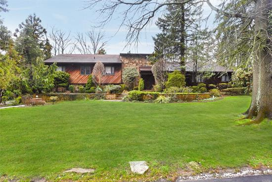Spacious 6 Br, 4.5 Bth Split On 3/4 Acre Resortlike Property In Sd#14(Hewlett-Woodmere). Updtd Gran/Maple Eik, Lr W/ Vaulted Ceiling, Fdr, Den & Sun Rm. Mstr Suite Features Bath & Walk In Closets(Was Bedroom) Large Bsmt Can Be Finished(Hi Ceiling). 2 Car Att Garage. Oak Flrs Throughout, Crown Moldings, New Cac, Cvac, Ig Sprinklers. Low Taxes & Low Utility Bills