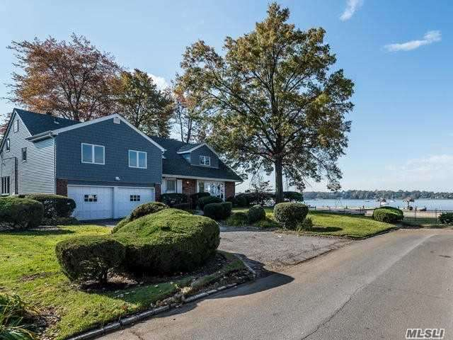 Beautiful Waterfront Home On Manhasset Bay. Spectacular Views From Almost All Principle Rooms. Offers 4 Bedrooms, 3 Baths, Family Rm And A 2nd Family Rm/Or Addit 5th Bdrm. Beautiful Hardwood Floors Throughout. 2-Car Attached Garage. Private Beach And Mooring Rights With Associations Fee. Kayaking, Fishing, Swimming, Boating, Restaurants. Enjoy Sunrise And Sunsets. Located Within Close Proximity To Town And Train.