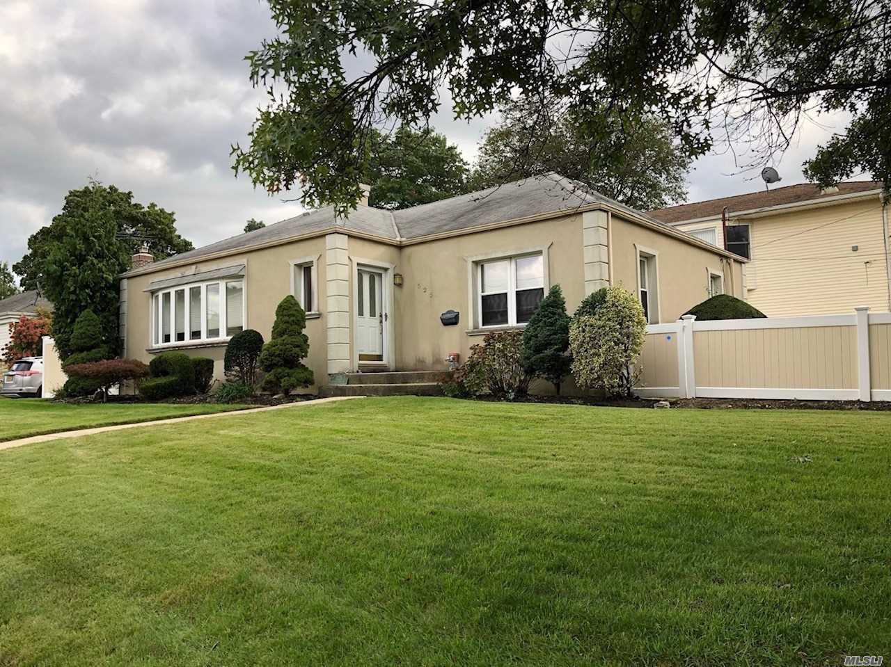 Well Kept Home Featuring: Cac; Oversized Eat-In-Kitchen With Wood Cabinetry, Granite Counter Tops, Stainless Steel Appliances; Large Living Room With A Wood Burning Fireplace; Hardwood Floors; Vinyl Fencing, Patio With Pavers, Very Large Unfinished Basement. Close To Lirr, Hwys, Shops