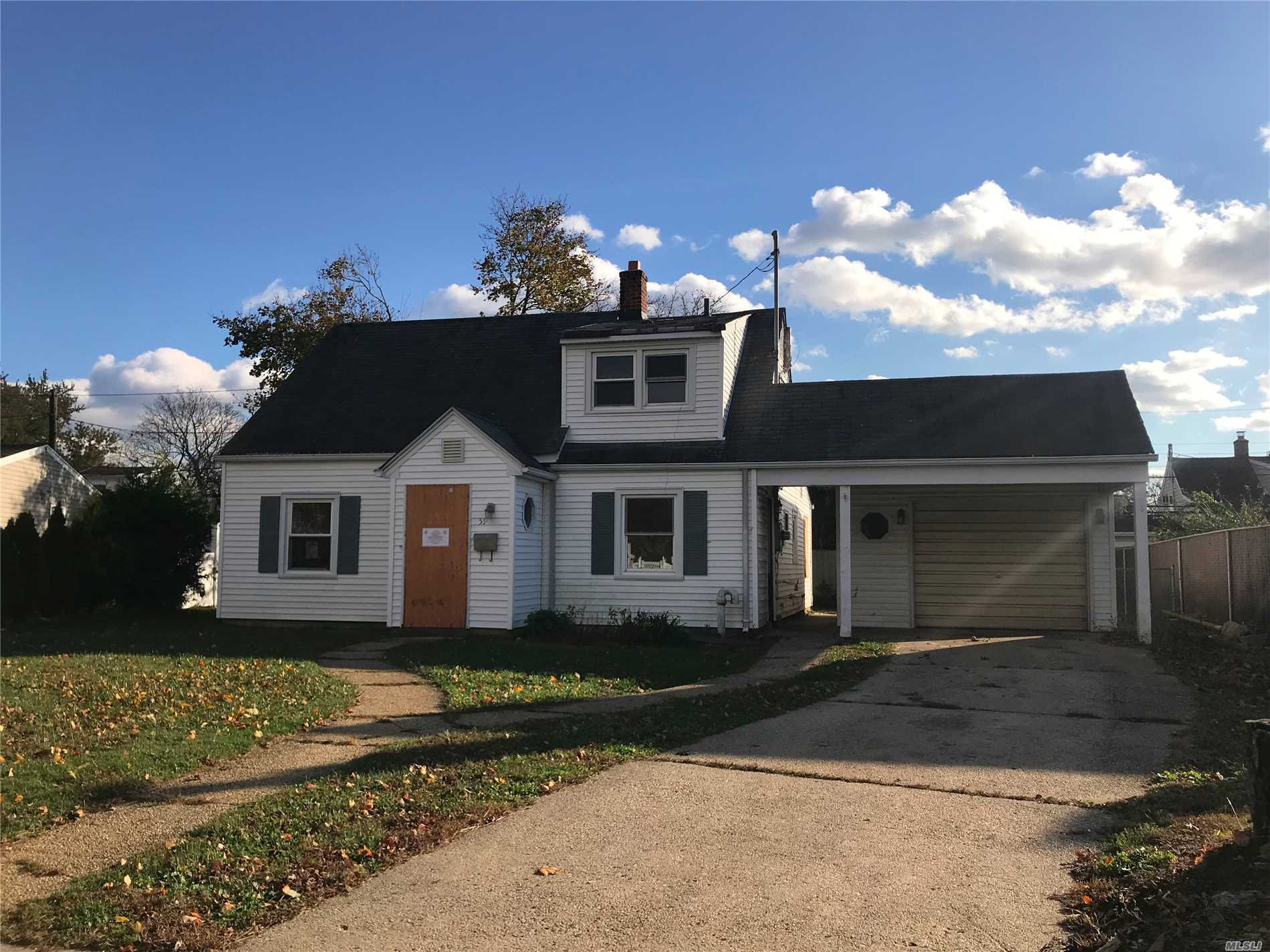 Phenomenal Single Family Opportunity In Levittown. Bank Owned Property, Ready To Go. Fully Cleaned Out Cape On A Quiet Residential Block; 3 Bedroom Duplex With 2 Full Baths; 1 Car Garage. Near Hempstead Turnpike; All Parkways; Shops; Etc.