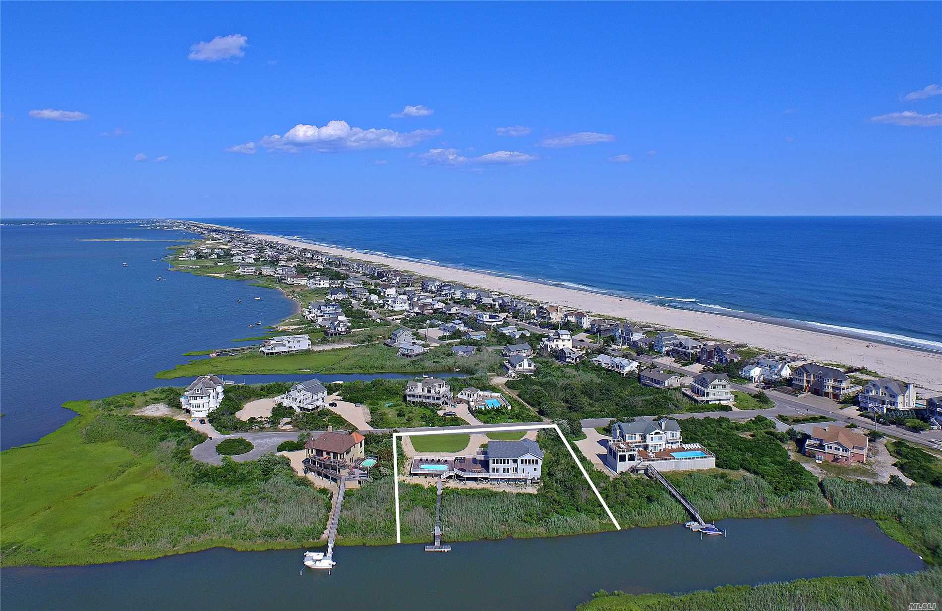 1.1 Acres Post Modern Bayfront. Great Room, 4 Bed & 3 Bath. 2nd Floor W Gourmet Kit, Dining Area, Master Bedroom Wi Bath & Balcony. Expansive Mahogany Decking, Covered Outdoor Kitchen, Gunite Pool, Canal Front Boat Dock, Rolling Lawns, & Access To Ocean Beaches.