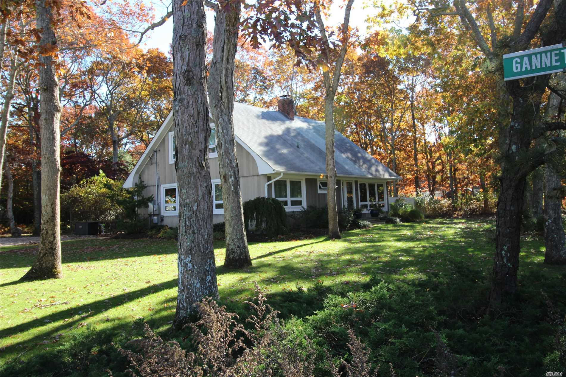 Immaculate Cape Cod In Private Waterfront Community 3 Blocks To Beach. Home Features Living Room With Fireplace, Hardwood Floors Throughout, Open Dining Room/Living Room Combo. Eat In Kitchen, 2 Bd. 1 Ba. On 1st Floor. Large Cathedrel Ceiling Master Bedroom On 2nd Floor With Private Bath & Kitchinette Area With Sundeck. Also Rear Sundeck, & Hot Tub. Lovely Grounds With Sprinkler System. Whole House Generator. Ceiling Fans. Boat Dock Available.