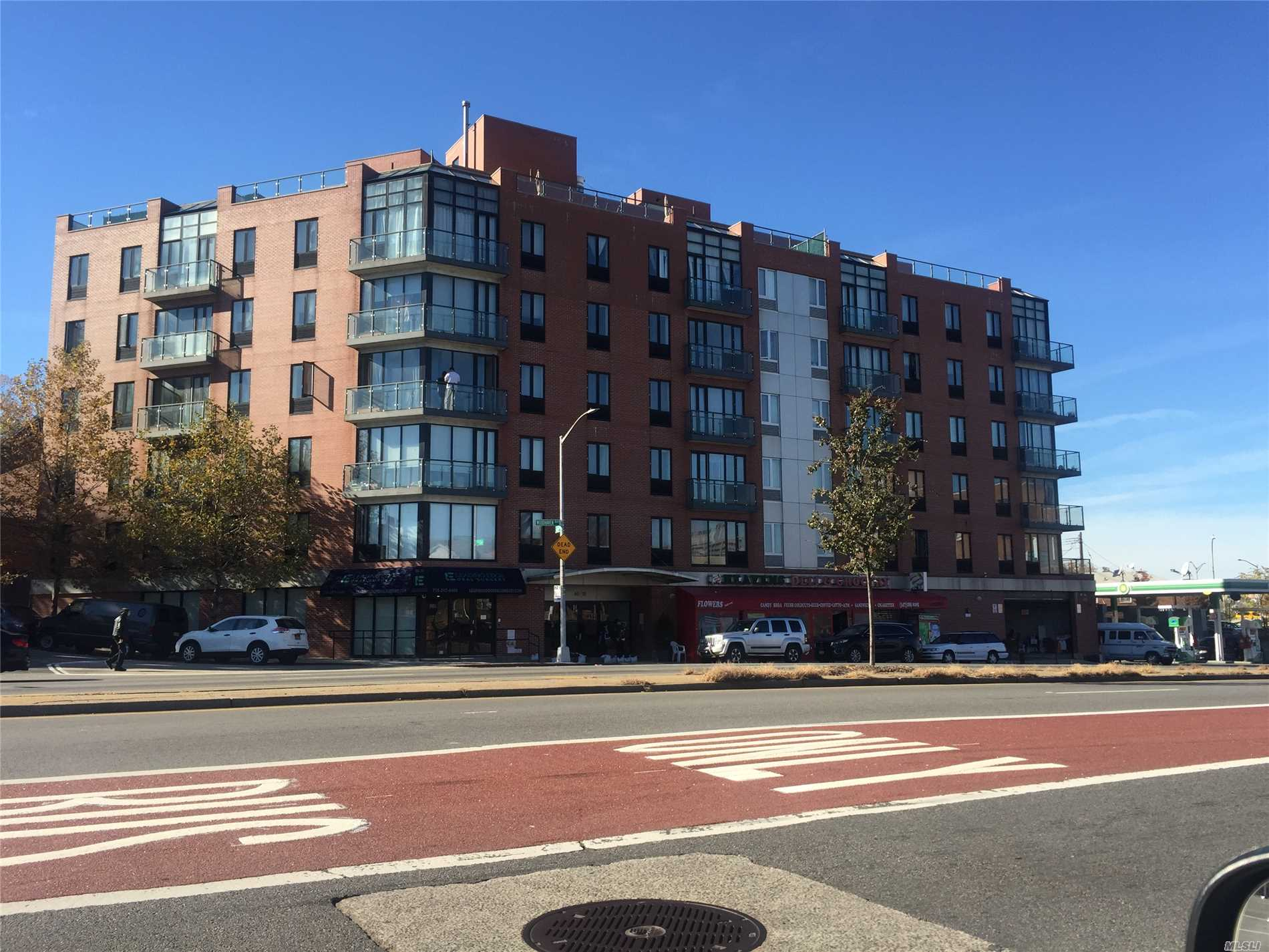 Priced Right. See This Beautiful Modern Unit With Wood Floors, Modern Eat-In-Kitchen With Island, & Terrace Overlooking 1st Floor Patio. Near Trains, Queens Center, Restaurants, 1st Floor Shops, Highways And More. Only 25-30 Minutes To Nyc By Train. It's A Well Kept Modern Elevator Building.