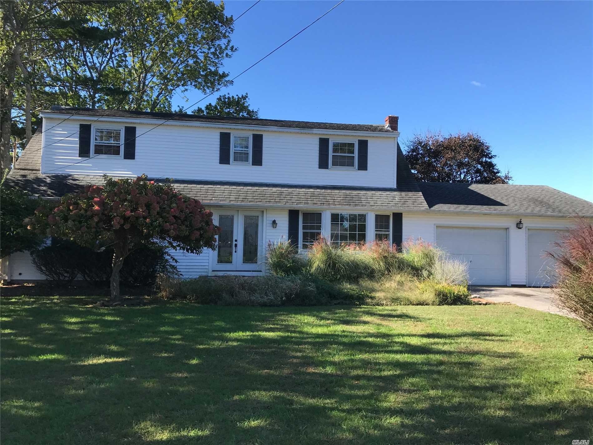 Lovely, Large Family Home In A Quiet Neighborhood. 5 Bed/2 Ba. Sunroom On Western Side. Backs Up To Open Space. Bay Beach At End Of Block. Great Yard.