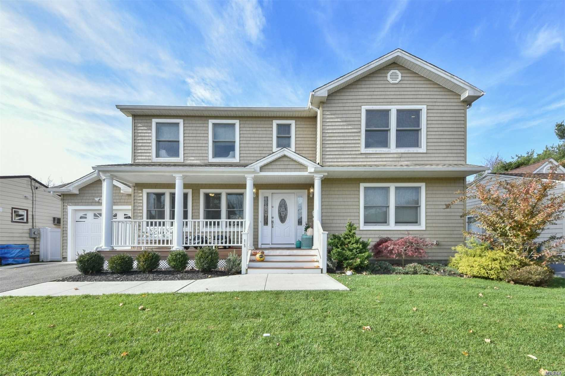 This 4 Year Old Colonial Shows Like New.Located Mid Block On Lush Manicured Landscaped Property With A Country Club Like Backyard Featuring, S/S Granite Center Isle Custom Cabinets Eik, 3 Beautful Bathrooms, 4 Brs On 1 Level, 200 Amps, Trex Porch, Hardwd.Many Energy Efficient Features Including Appliances , Furnace, Cac, Windows, Etc. Taxes Being Grieved For The 1st Time!!!!A Must See!Seller Will Offer $5000 A Year For 3 Years Towards Taxes!!MAJOR PRICE IMPROVEMENT!!