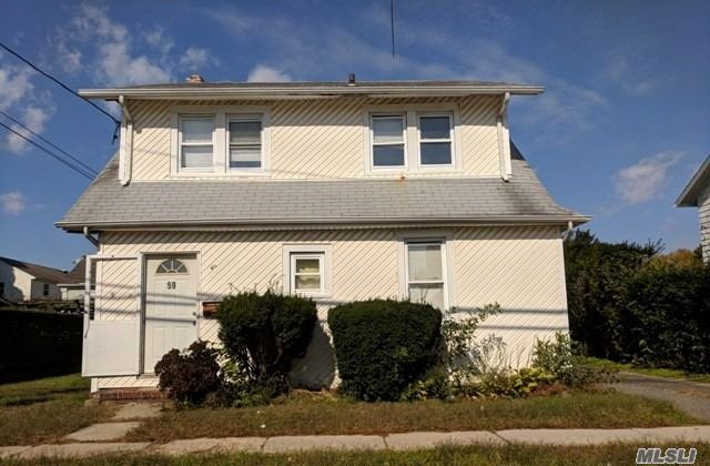 Legal Two Family Home, Being Sold Occupied, In The Heart Of Hempstead Near Everything You Could Want & Need. A Great Investment/Rental Income Property For The Right Buyer!
